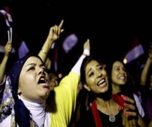 Opponents of Egypt's Islamist leader Mohammed Morsi celebrate outside the presidential place after the chief justice of Egypt's Supreme Constitutional Court, Adli Mansour, was sworn as the interim president on Thursday.