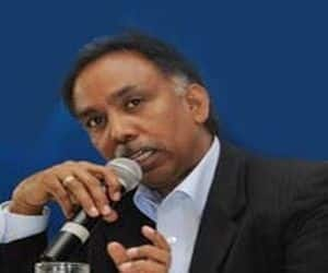 Infosys boss Shibulal Takes Pay Cut
