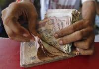 Cash transaction charges levied by banks: should you worry?