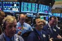 Wall Street flat, at record high, as UPS offsets banks
