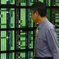 Asian stocks get a boost from US lead, firm oil price
