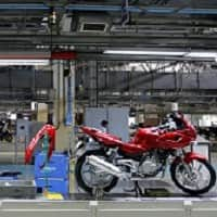 Bajaj ready to rough it out even as workers postpone strike