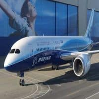Boeing boosts share buyback to $14 billion, hikes dividend