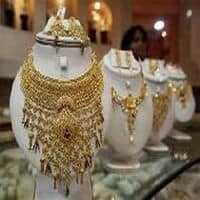 Gold falls on low demand; silver rises on global cues