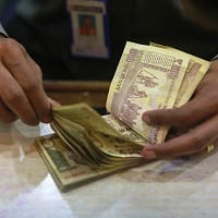Rupee opens marginally higher at 67.02 per dollar