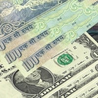Rupee extends losses, down 14 paise in late morning deals