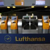 Lufthansa chief rejects 'subsidies' as he signs Etihad deal