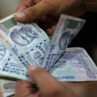 Rupee opens lower at 66.74 per dollar