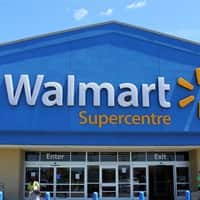 Wal-Mart earnings dip but beat expectations