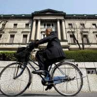 BOJ to defend QQE in September policy assessment: Sources
