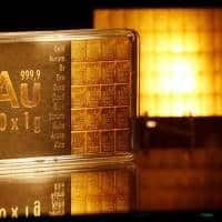 Gold holds overnight gains; US data back in focus
