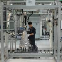In China's electric car boom, automakers select different gear