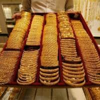 Gold prices slip as equities, dollar gain