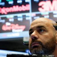 Wall Street dips as telecoms slump; AmEx surges