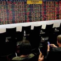 Asia slips on weaker oil, Dollar near 7 month high as euro slips