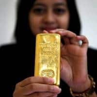 Gold rises from 10-month lows as dollar sags