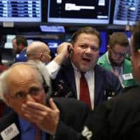 Wall Street little changed as bank rally pauses
