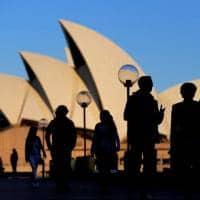 Australia economy slams into reverse, hopes to dodge recession