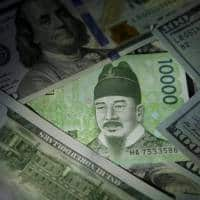 S Korea holds rates as political scandal put c.bank in bind