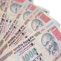 Rupee opens flat at 67.04 per dollar