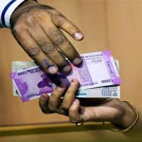 Rupee opens at 67.84 per dollar; down 10 paise