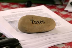 When can service tax and VAT be levied on purchase of property