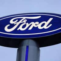 Ford sees lower 2017 profits, takes hit from pensions, Mexico