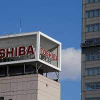 Toshiba shares slide after it says could sell more of chip biz