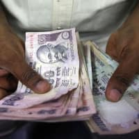 Rupee rebounds 26 paise to 64.41 against US dollar