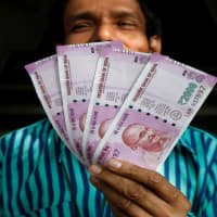 Indian rupee pares early gains, down 5 paise vs USD