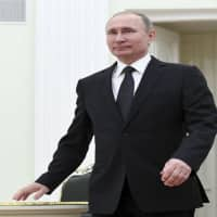 Putin says claims that Russia interfered in US elections are 'lies'