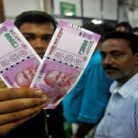 Indian rupee declines to 64.15 on month-end demand for USD
