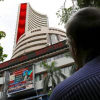 Caution ahead of Infosys Q4 nos drags Sensex 145 pts; pharma helps Nifty hold 9200