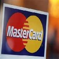 MasterCard profit rises on spending, but fee caps loom
